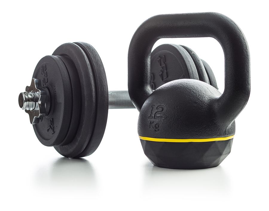 The black kettlebell and dumbbell isolated on white background.